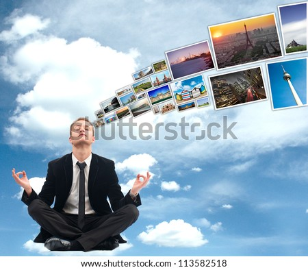 A young business man thinking about hoidays during yoga - stock photo