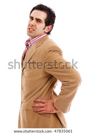 A young business man with a backache, isolated on white - stock photo