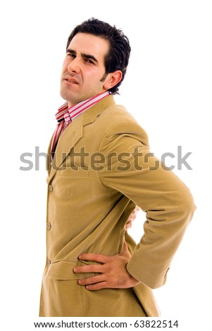 A young business man with a backache. Isolated on white - stock photo