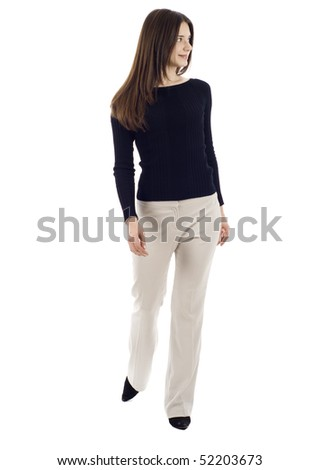 A young business woman is walking. She is smiling and looking away from the camera isolated over white background