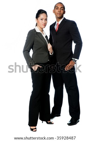 A young businessman and businesswoman standing together on white background