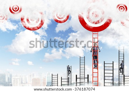 A young businessman climbing a red ladder to the sky, two men climbing other ladders. Red targets at the top. Blue sky and city at the background. Concept of career growth. - stock photo
