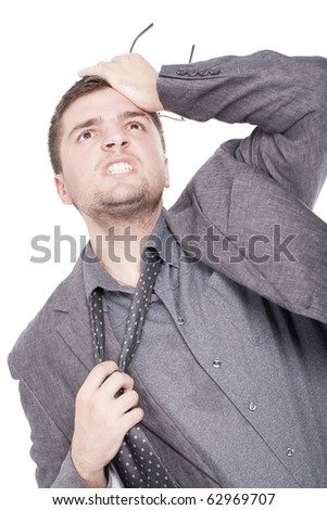 A young businessman employee is getting a headache from all the stress - stock photo