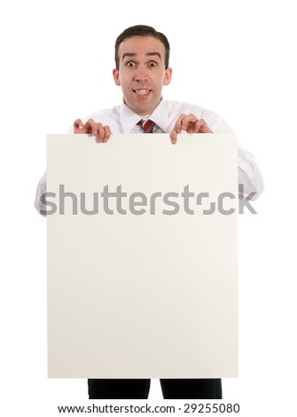 A young businessman holding up a blank sheet of paper, isolated against a white background