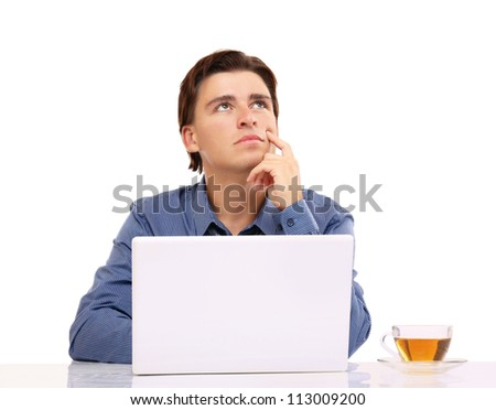 A young businessman in front of a laptop, isolated on white - stock photo
