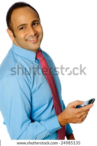 A young businessman in shirt and tie holding a mobile phone. Isolated on white background.