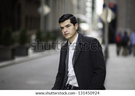 A young businessman is sitting by a street and into deeply thinking./Portrait of Young Businessman - stock photo