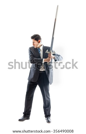 A Young Businessman isolated on a white background holding a steel sword - stock photo