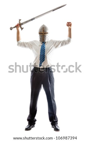 A Young Businessman isolated on a white background holding a steel sword and wearing an helm - stock photo