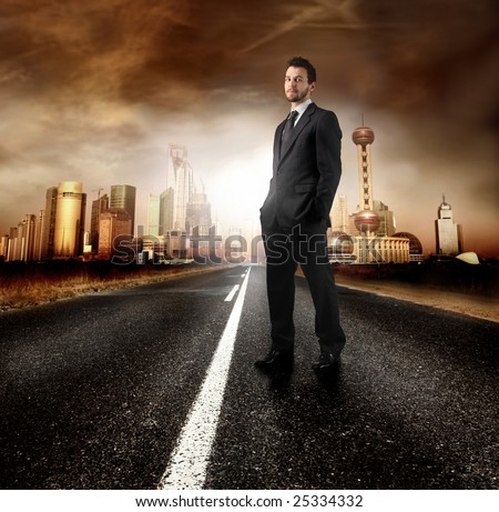 A young businessman on the road of a modern city