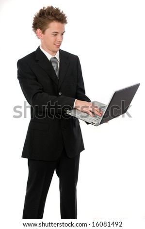 A young businessman standing up using a laptop
