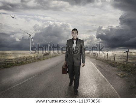 A young businessman walking on the road - stock photo