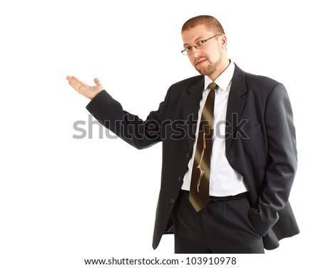 A young businessman wearing glasses, suit, tie and white shirt, one hand in pocket, and the other hand showing something - isolated on white - stock photo
