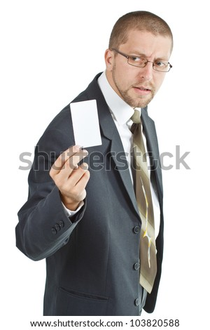 A young businessman wearing suit and tie is holding a blank card in his right hand - isolated on white - stock photo