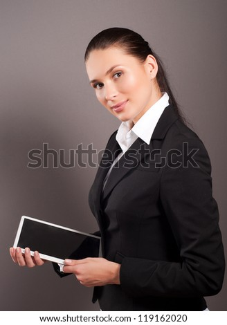 A young businesswoman holding her digital tablet pc