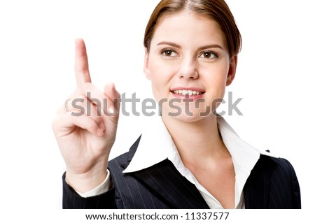 A young businesswoman pointing - stock photo