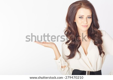 a Young businesswoman presenting something in a white studio