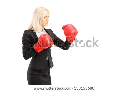 A young businesswoman with red boxing gloves ready to fight isolated on white background - stock photo