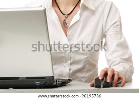 A young businesswoman working on a laptop, isolated on white background