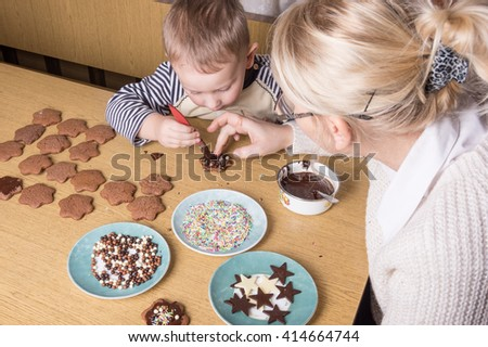 a young caucasian boy decoratingcookies