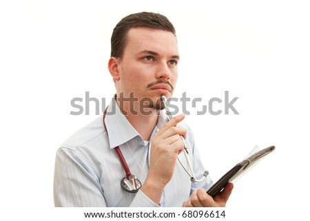 A young caucasian doctor thinks deeply - stock photo
