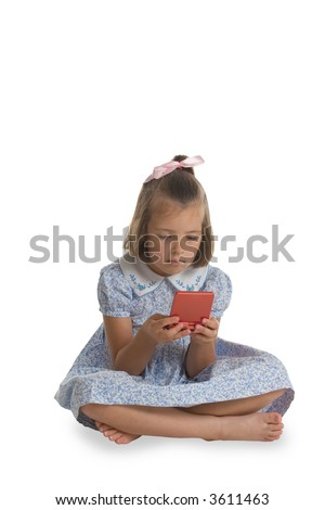 A young, Caucasian girl playing an electronic game. This image is one of a series of conceptual images isolated on white backgrounds.
