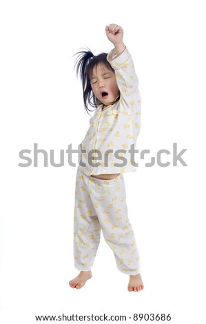 A young child stretching as she wakes up. - stock photo