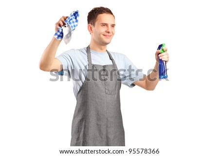 A young cleaner holding a cleaning supplies isolated on white background - stock photo
