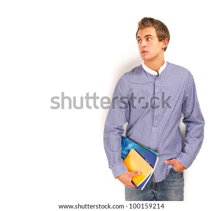 A young college guy with books - stock photo