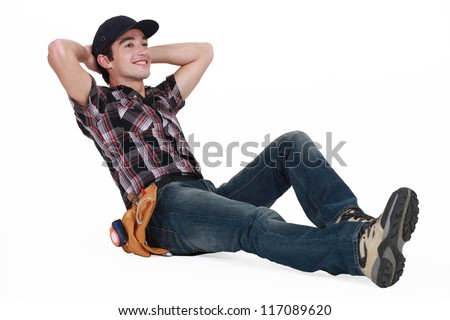A young construction worker resting. - stock photo
