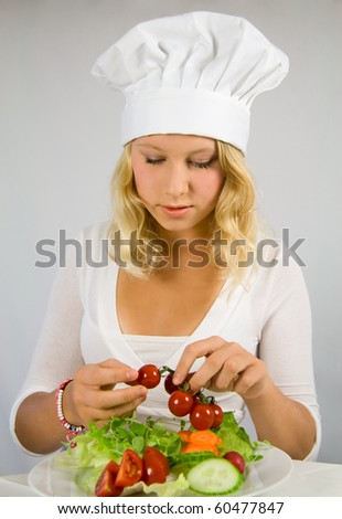 a young cook garnished salad
