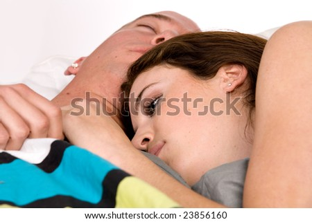 A young couple being together in bed