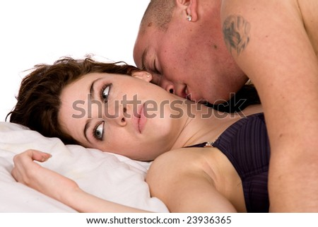 A young couple being together in bed - stock photo