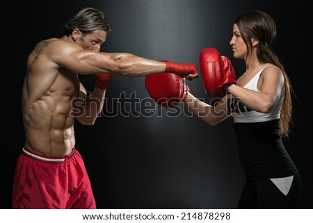 A Young Couple Boxing For Fitness - Bodybuilding Couple Posing With Boxing Gloves On Black Background