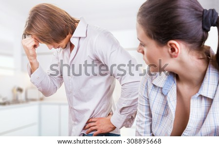 A young couple discovers the relationship in the kitchen - stock photo