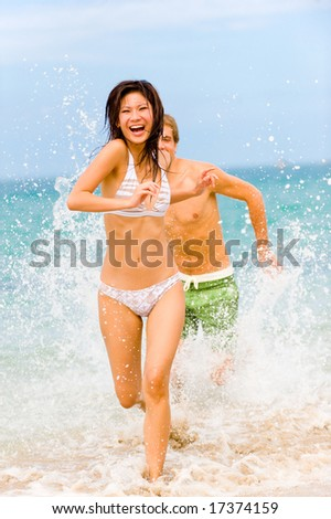 A young couple having fun on a tropical beach