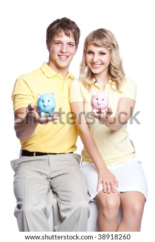 A young couple holding a piggy bank, can be used for finance or saving concept