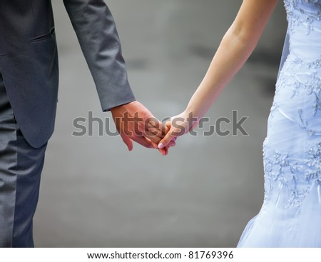 A young couple holding hands