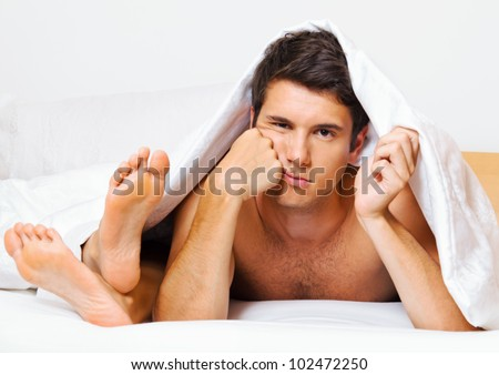 a young couple in bed has problems and crisis. divorce and separation. - stock photo