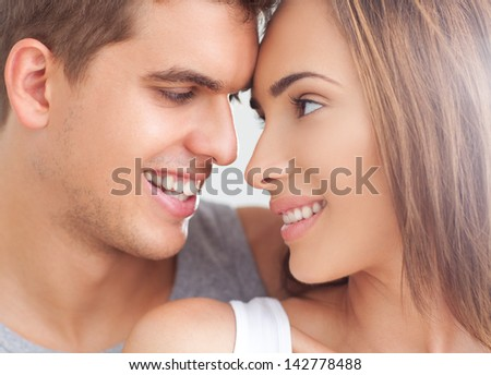A young couple looking at each other. - stock photo