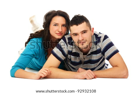 A young couple lying on the floor , isolated on white background - stock photo