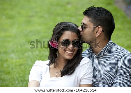 A young couple on a grass background. - stock photo