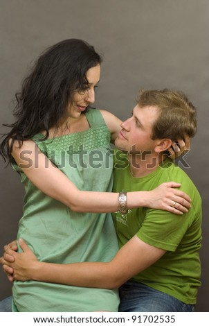 A young couple posing in studio