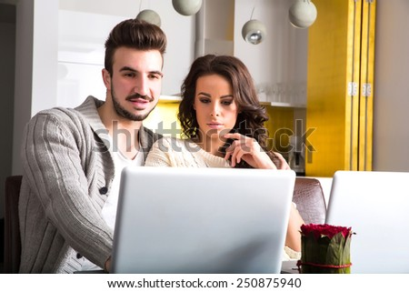 A young couple using in the evening their laptop computers at home.  - stock photo