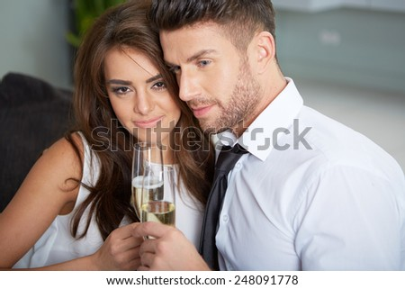 a young couple with champagne glasses celebrating