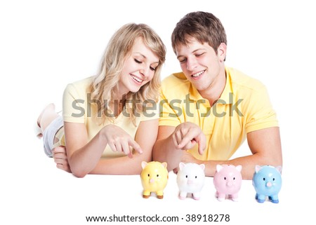 A young couple with piggy banks, can be used for finance or saving concept - stock photo