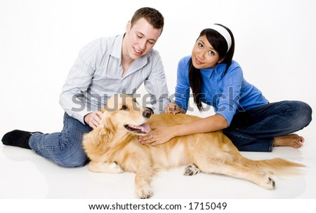 A young couple with their pet golden retriever