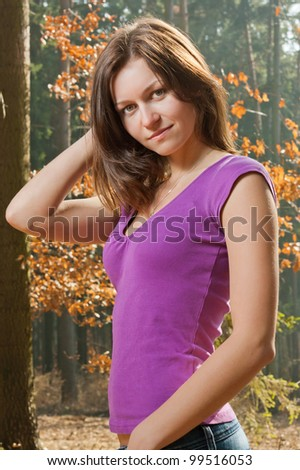 A young Czech woman in a little wood of Moravia.