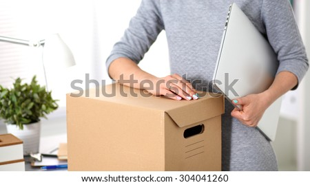 a young employee of the office is ready to move - stock photo