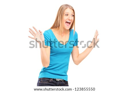 A young excited woman gesturing isolated on white background - stock photo